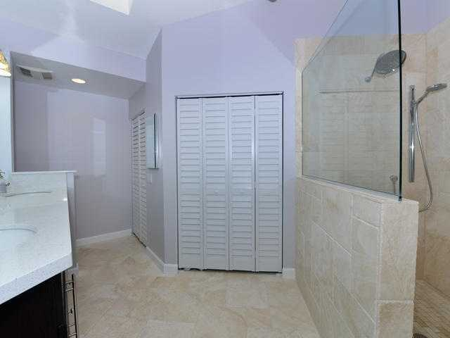 Master bathroom features dual sinks and a large walk-in closet.