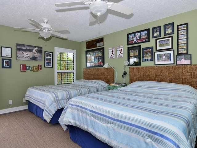 These spacious guest suite is one of three bedrooms in the home.