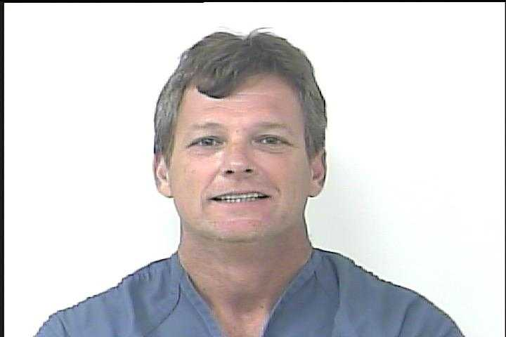 John Gibson was arrested for allegedly abusing a dog at a pet adoption event in Fort Pierce over the weekend.