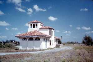 Abandoned railroad station in Everglades City. (1960s)