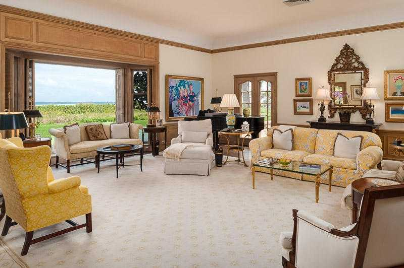 Folded screen doors reveal spectacular views in the formal living room.