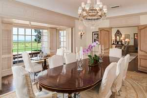 The floor-to-ceiling window in the dining room emphasizes how the home is built to take advantage of the gorgeous views.