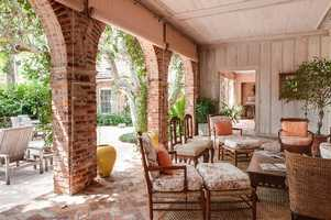 The beautiful lanai also features brick arches.