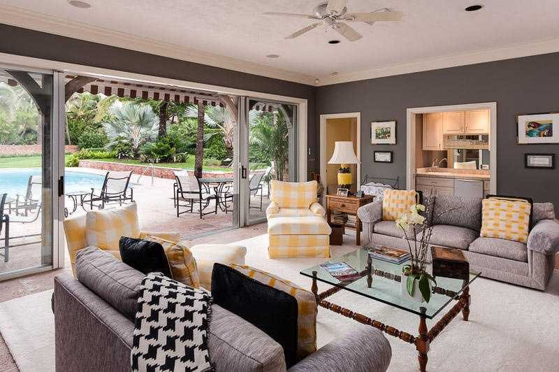 Sliding doors provide access from the pool to the family room.
