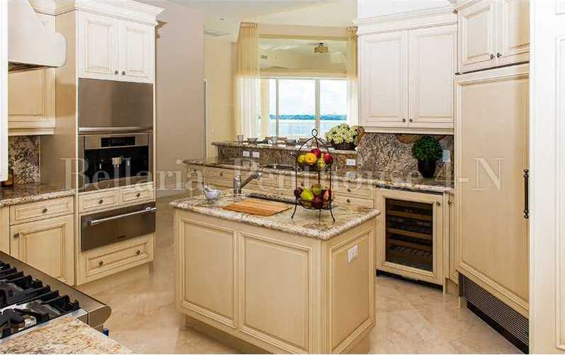 Kitchen features top-of-the-line appliances, granite back-splash, and tile.
