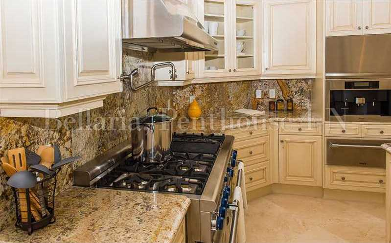 The cabinets and granite contrast seamlessly.