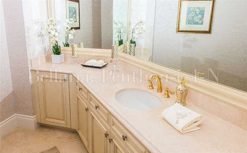 Master bathroom features a large mirror and plenty counter space.