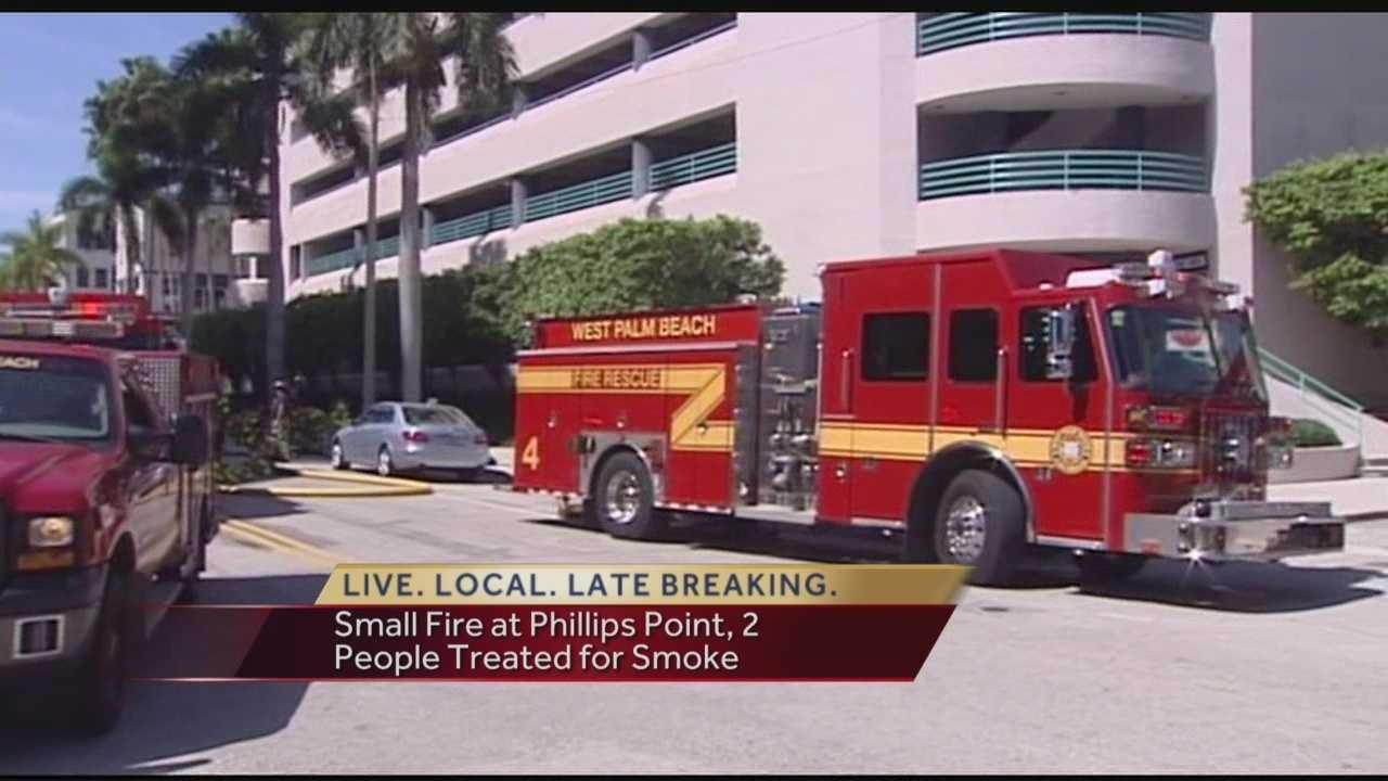 Firefighters responded to a fire inside the Phillips Point building in West Palm Beach on Thursday. Crews said the fire originated in the trash compactor in the parking garage.