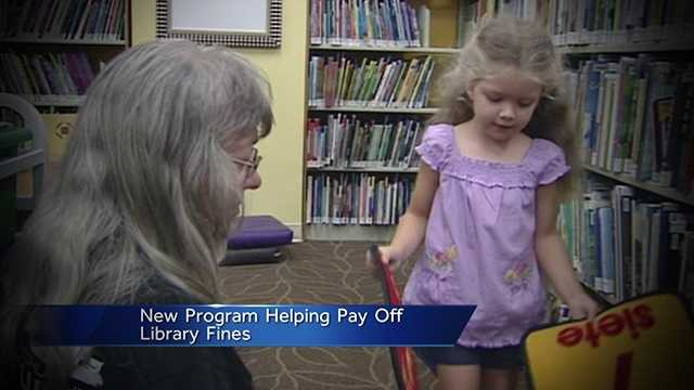 A program set to launch in June will allow kids to cut down their overdue-book fines by reading at the library.