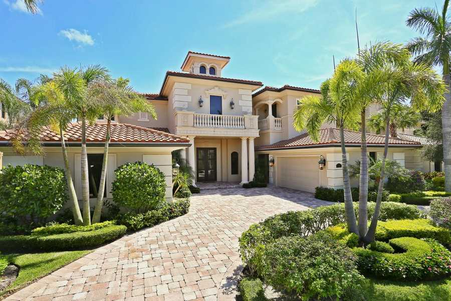 Feast your eyes on 5 bedrooms and 6 lavish baths, 3 half baths plus an office, theatre room, upstairs entertainment area, 2 laundry rooms and tranquil patio/pool including a summer kitchen.