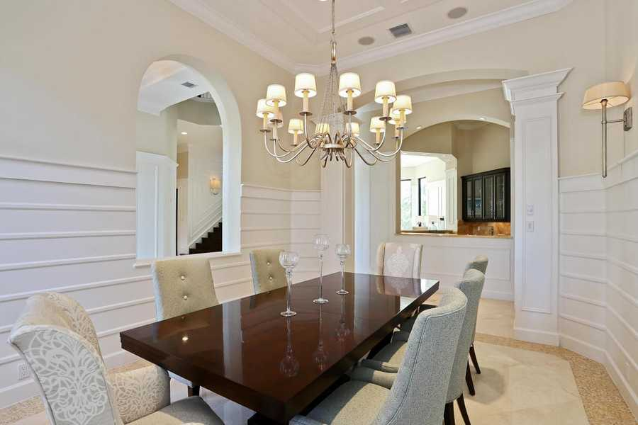 Gorgeous dining room includes a blend of modern and traditional style in a seamless fashion.