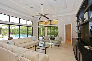Comfortable family room offers panoramic views and a custom entertainment unit.