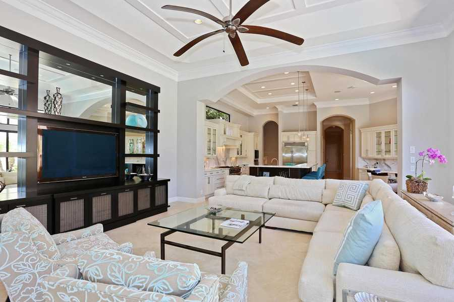 This family room also features exquisite tiered, vaulted ceilings.