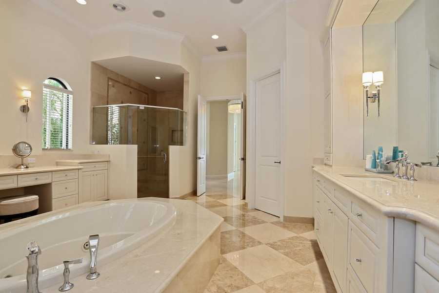 Massive spa tub sits in the middle of this master bathroom.