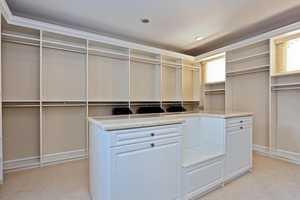 Expansive master closet, features a custom wardrobe design.