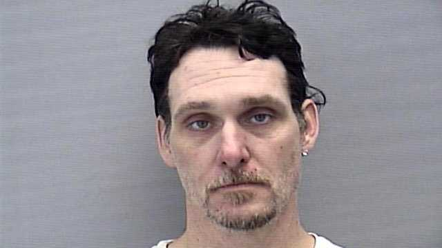 "Hoyt Elie Adams was arrested after police say he dove through his neighbors' windows while under the influence of the drug ""Molly."""