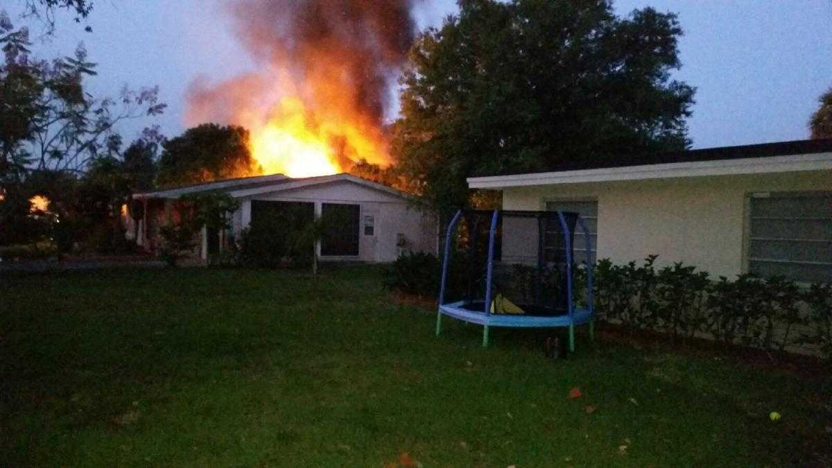 A photo of a fire that took the lives of two people inside of a mobile home/camper early Friday morning.