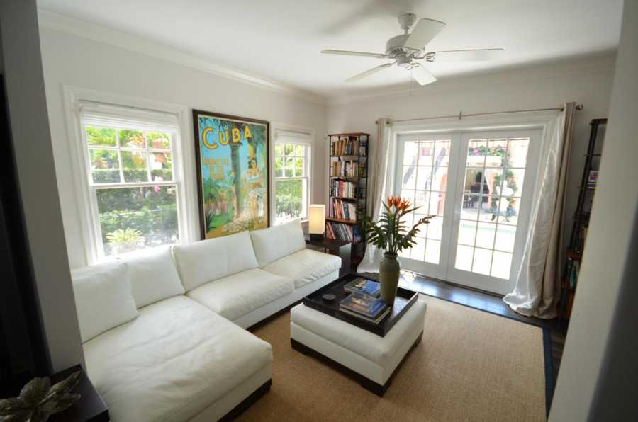 The family room features large windows for plenty natural light.
