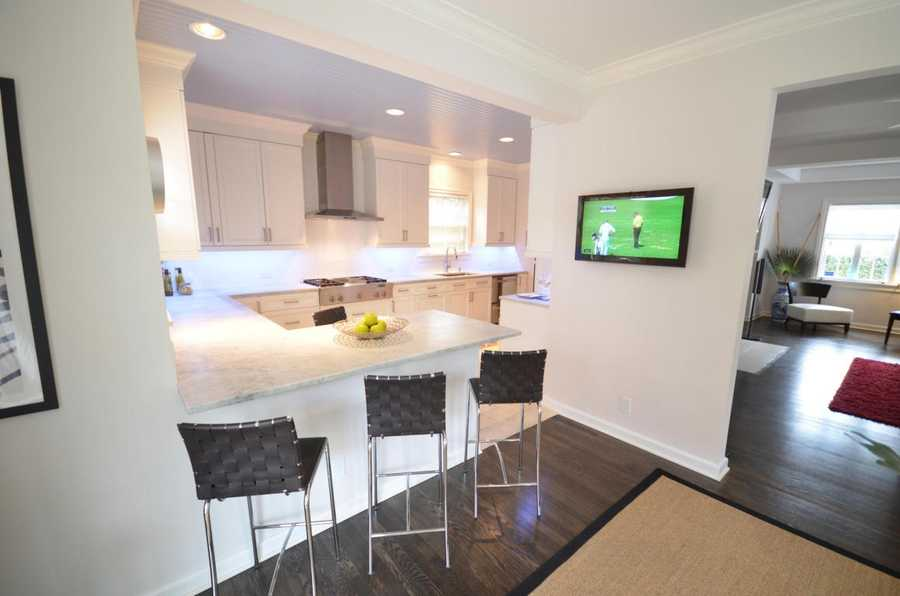 Kitchen features Carrera marble counter tops.