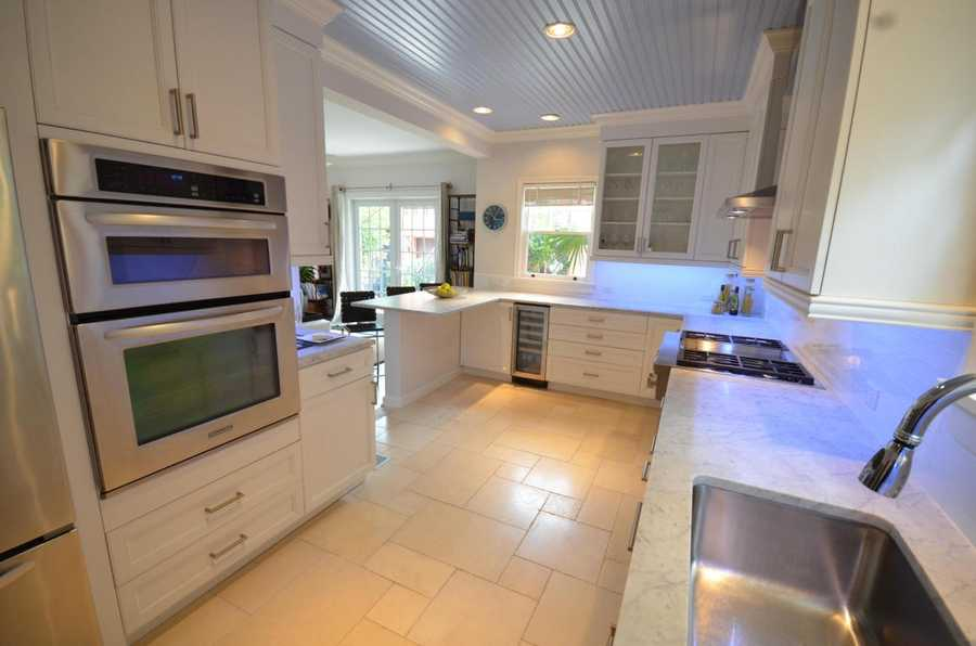 The kitchen is also fully equipped with gas stove and stainless steel appliances, including double oven.