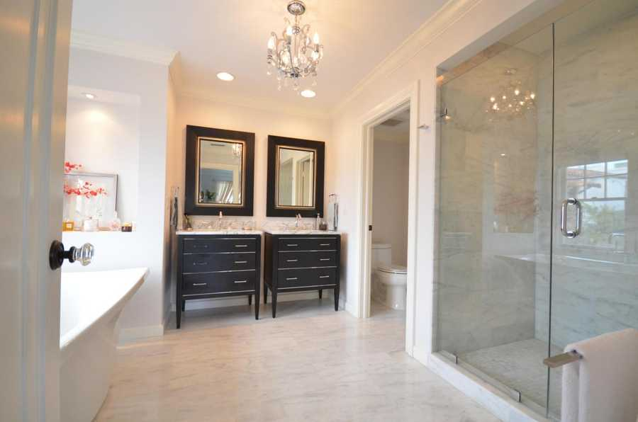 Master bathroom might be the most elegant area of the home. It boasts marble floors, marble covered shower, and chic dual vanities.