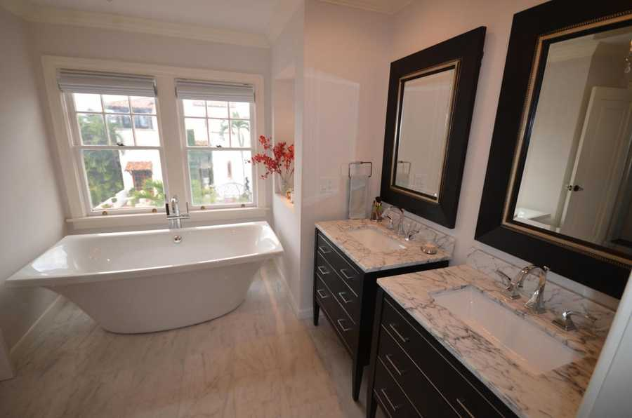 Large free-standing tub is tucked away and has a perfect view.