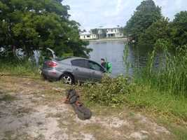 MAY 27: Two people were rushed to a hospital after the car they were in plunged into a canal in Delray Beach on Tuesday.