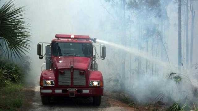 Officials on Wednesday evacuated portions of northern St. Lucie County because of a brush fire.