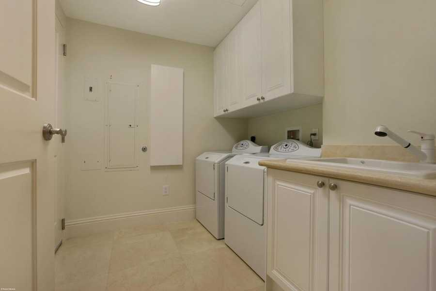 Full washer and dryer and generous sink in the laundry room.
