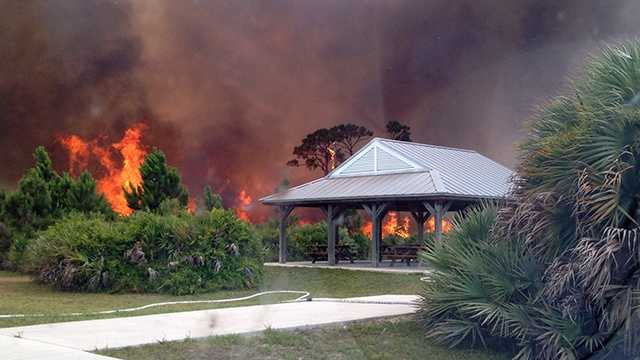JUNE 11: An out-of-control brush fire is causing problems on the Treasure Coast on Wednesday.