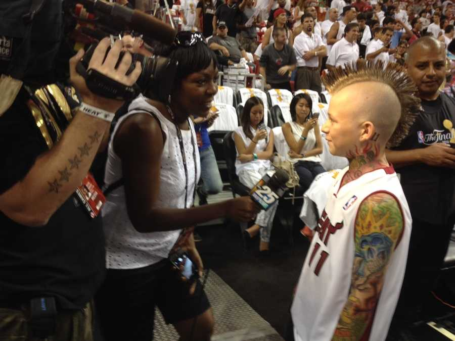 """JUNE 12: A young Chris """"Birdman"""" Anderson fan weighs in with Angela Rozier on the Heat's chances in Game 4."""