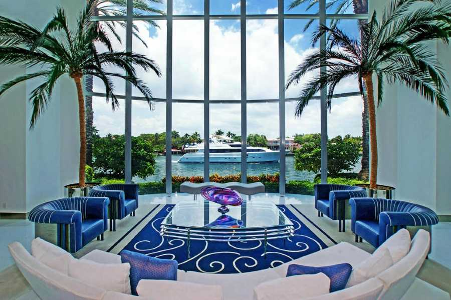 Floor-to-ceiling windows in the formal dining room. As previously mentioned, this estate is compatible for a mega yacht.