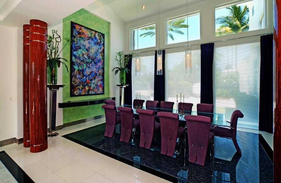 Formal dining room features a pool view and seating for 12.