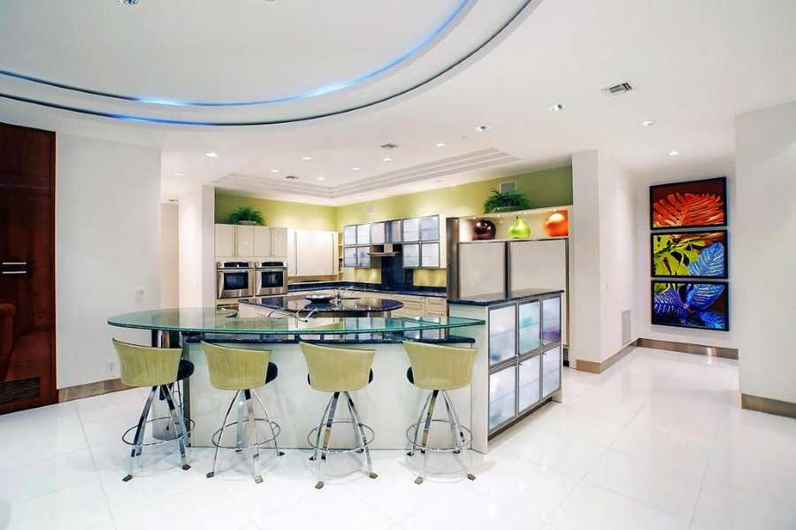 Modern kitchen design includes bar seating for four.