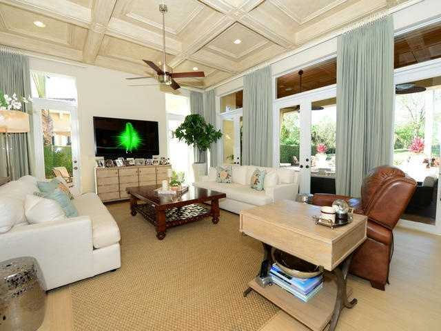 Formal living room overlooks the pool.