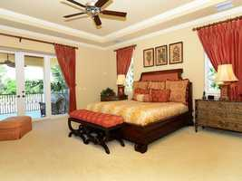 The master bedroom features views of the golf course, pool and spa.