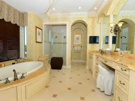 The master bathroom boasts a spacious spa tub.