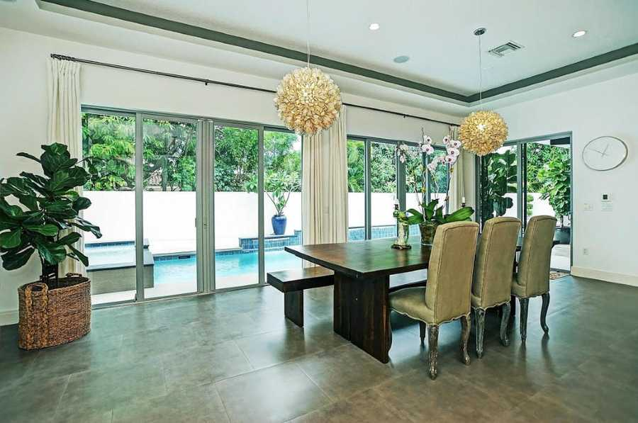 The minimalistic dining room offers spectacular views of the pool.