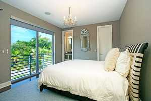 This guest suite is one of four remaining bedrooms in the home. It also features an en suite bathroom.