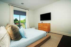 This bedroom features views of the landscaped premises.