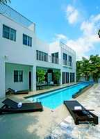 Enjoy a hot day by taking a dip in the pool or bask in the sun on the rooftop balcony.For more information on this property, visit Realtor.com.