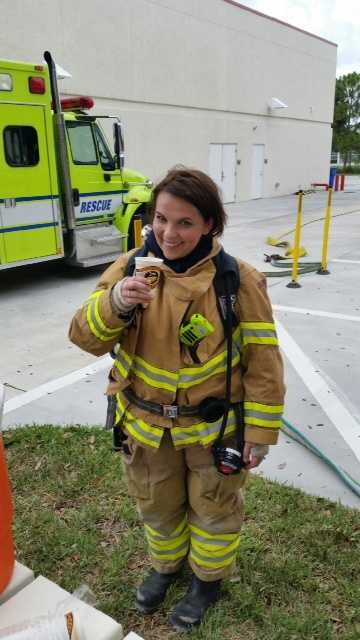 In over 40 lbs. of protective gear, hydration is a must. Stephanie Berzinski takes a welcomed water break during training with Palm Beach Gardens Fire Rescue.