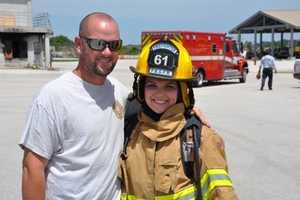 Stephanie Berzinski and her Fiance Michael Hodges, a former Winston-Salem North Carolina firefighter.