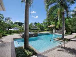 Between the main house and private dock, you'll find an amazing pool and spa.