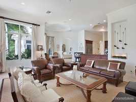 The kitchen and family room exist in a chic, open floor plan.