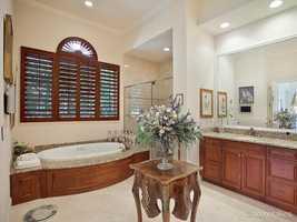 En suite master suite boasts a generous spa tub.