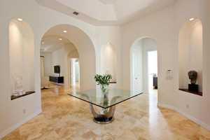 Saturnia Marble throughout plus Onyx & African Veneer builtins.