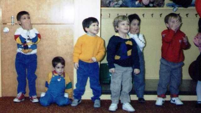 Who's that happy kid in the yellow sweater? Give it your best guess!