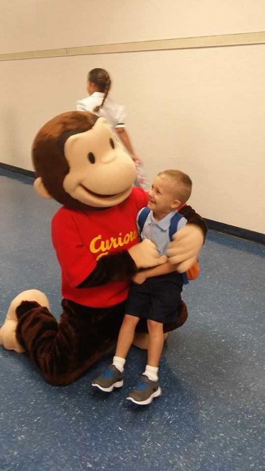 Curious George greets the children at elementary school. -- From Billie Jo Camp Anderson