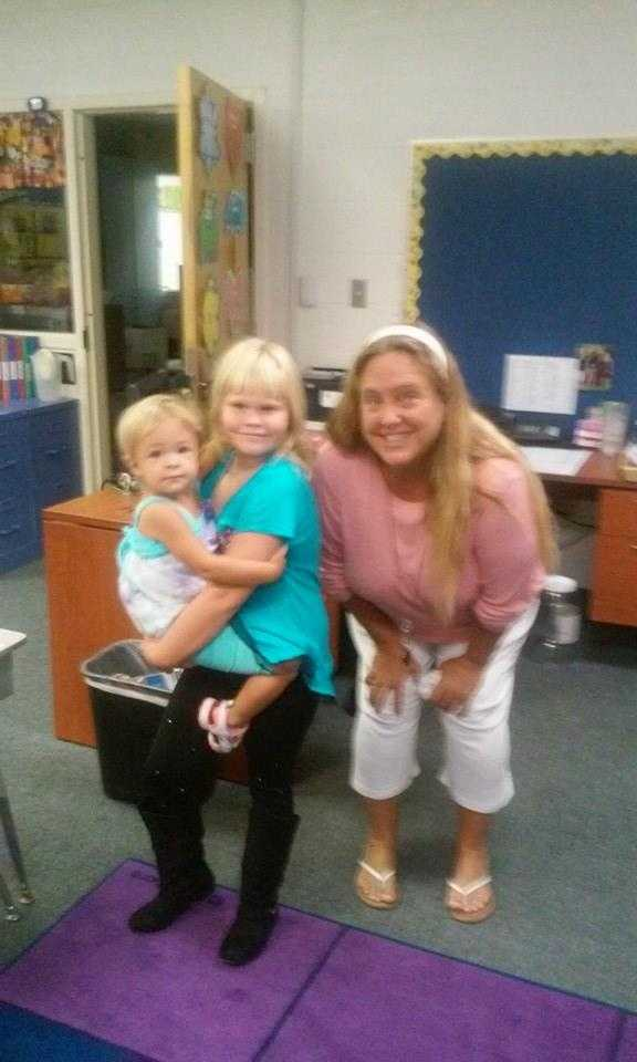Second grader here with her teacher and baby sister. -- From Cynthia Kernan